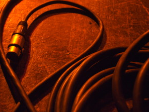 red-lit XLR audio cable on floor